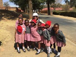 Maria Gonzales with school children, Lesotho