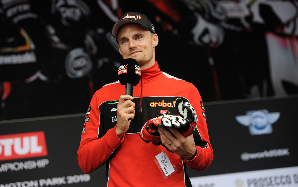 Chaz Davies auctions off his gloves, WorldSBK Auction at the Paddock Show, Silverstone