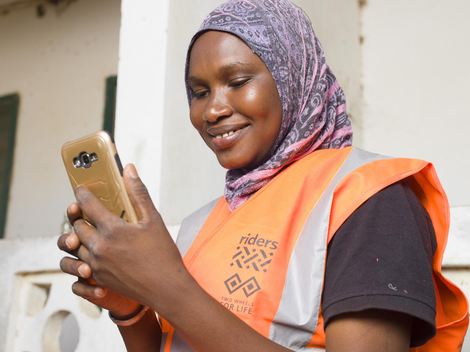 Health Worker using mobile handset, The Gambia