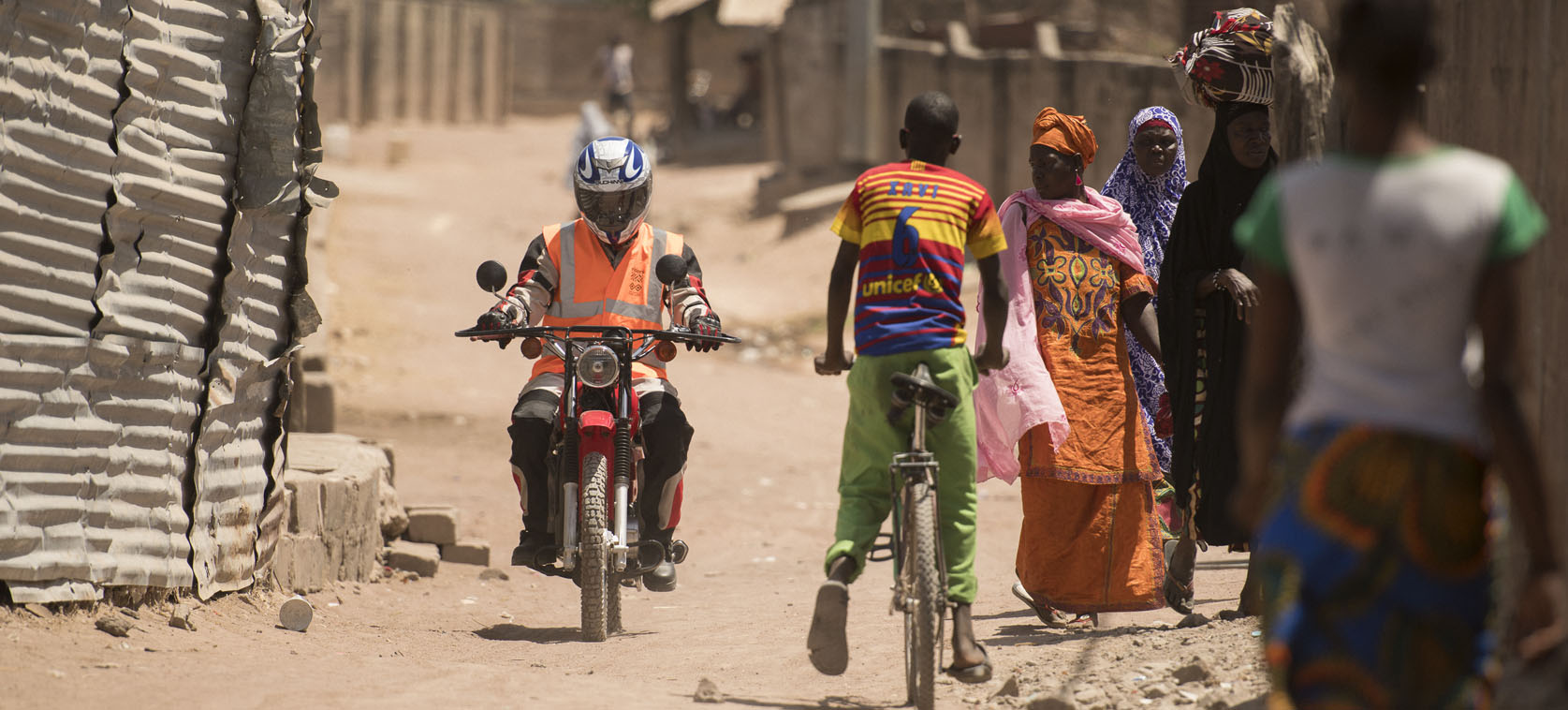 Healthworker on motorcycle, The Gambia