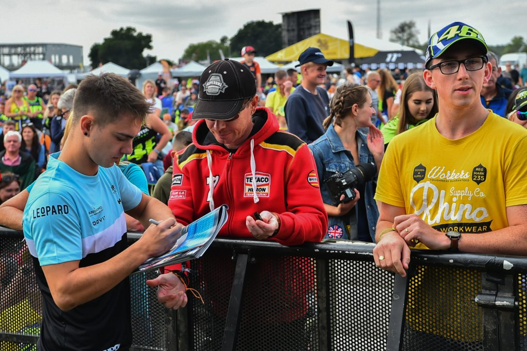 Tom Booth Amos Signs Autographs Day of Champions Silverstone MotoGP Two Wheels for Life