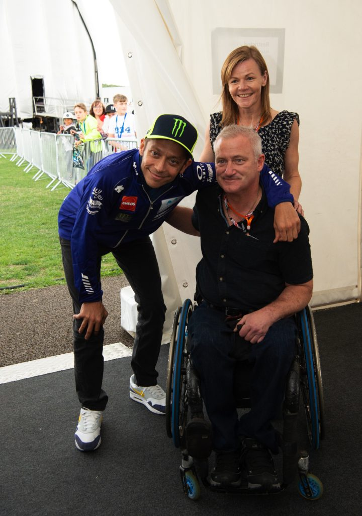 Valentino Rossi takes a photo with some of his fans