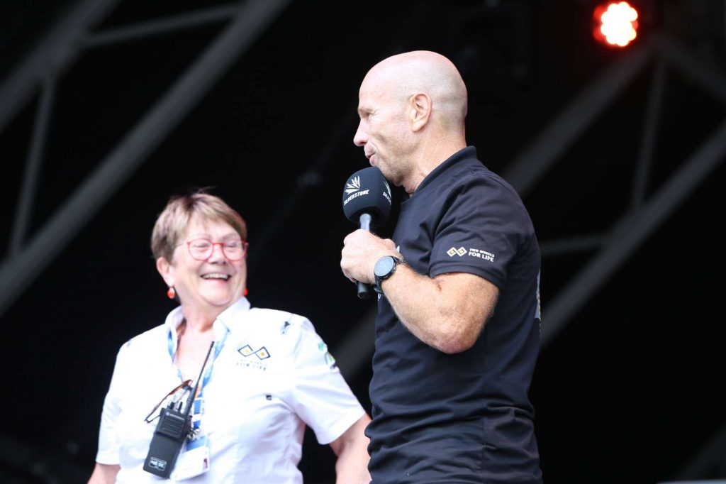 Andrea Coleman and Randy Mamola having a laugh on stage