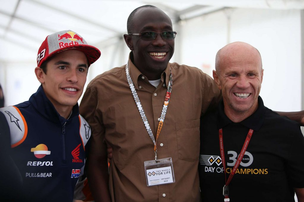 Randy Mamola and Marc Marquez with Ken Diko - Riders for Health the Gambia.