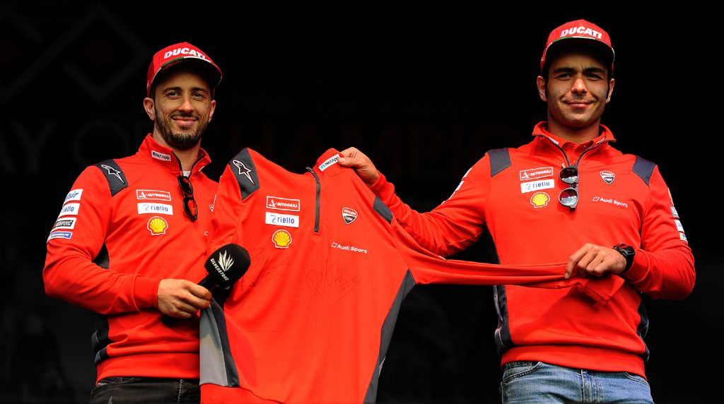 Dovizioso and Petrucci auction a signed team shirt