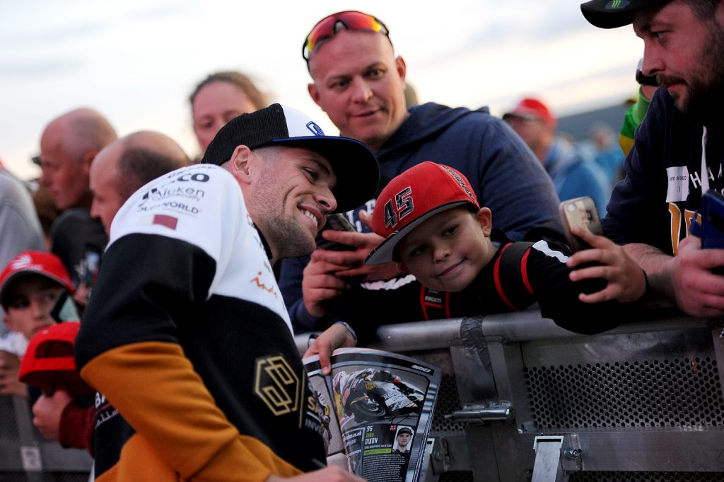 Jake Dixon has a selfie with a young fan