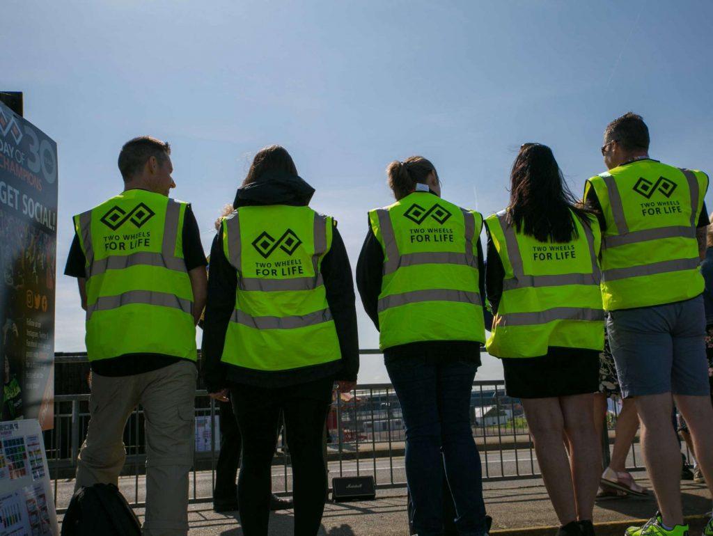 Volunteers showing off their branded bibs